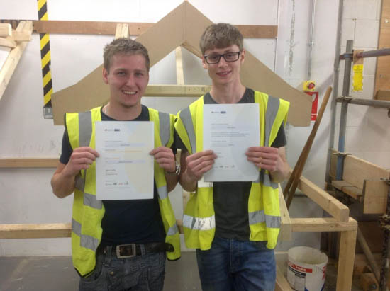 Apprentices displaying their certificates